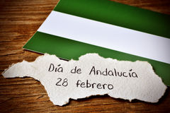 Text Dia de Andalucia, Day of Andalusia, in Spain. A piece of paper in the shape of Andalusia, in Spain, with the text Dia de Andalucia 28 de febrero, Day of Stock Photos