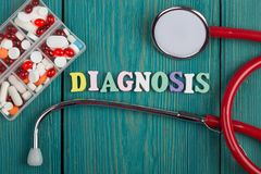 Text & x22;Diagnosis& x22; of colored wooden letters, stethoscope and pills stock image