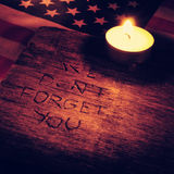 Text we do not forget you carved on wood, filtered Stock Photo
