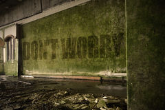 Text dont worry on the dirty wall in an abandoned ruined house. Text dont worry on the dirty old wall in an abandoned ruined house Royalty Free Stock Photo