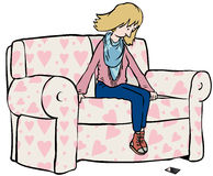 Text dump. Pensive woman on sofa looking at phone Royalty Free Stock Image
