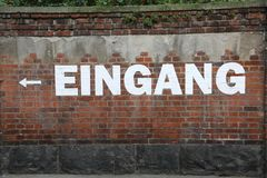 Free Text EINGANG On The Brick Wall Which Means EXIT In German Stock Photo - 99713040