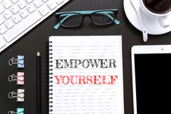 Text Empower yourself on white paper background / business concept Stock Photos