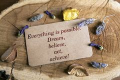 Everything is possible. Text Everything is possible.Dream, believe, act, achieve! in card on wood Royalty Free Stock Images