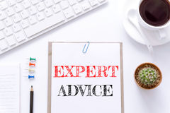 Text Expert advice on white paper background / business concept. Royalty Free Stock Photography