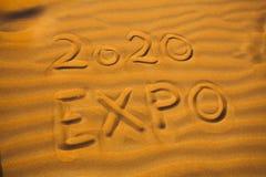 Text 2020 expo for Dubai concept. Written in desert sand stock images