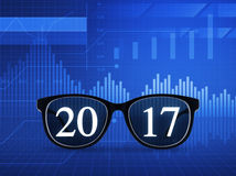 2017 text with eye glasses. Over financial graph and chart, New year business vision concept royalty free stock images