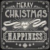 Text för glad jul för tappning på en svart tavla Arkivbilder