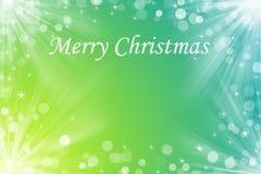 Text för glad jul på aquagulingbakgrund Royaltyfria Foton