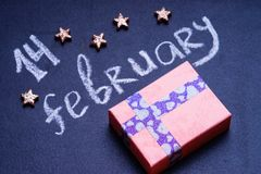 Text 14 february, stars shape and gift box. Text 14 february, stars shape and pink gift box for Valentine`s Stock Images