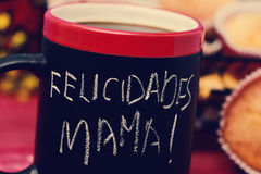 Text felicidades mama, congratulations mom in spanish. The sentence felicidades mama, congratulations mom in Spanish, handwritten with chalk in a black mug with Royalty Free Stock Photos