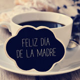 Text feliz dia de la madre, happy mothers day in spanish. The sentence feliz dia de la madre, happy mothers day in spanish in a blackboard in the shape of a Stock Photos