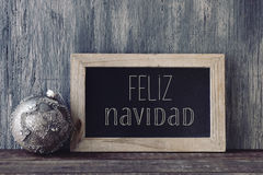 Text feliz navidad, merry christmas in spanish Stock Photos