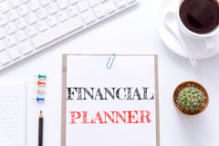Text Financial planner on white paper background / business concept Stock Photography