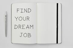 Text find your dream job in a notepad Royalty Free Stock Photos