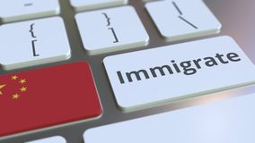 IMMIGRATE text and flag of China on the buttons on the computer keyboard. Conceptual 3D animation. Text and flag on the buttons on the computer keyboard stock video footage