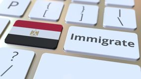 IMMIGRATE text and flag of Egypt on the buttons on the computer keyboard. Conceptual 3D animation. Text and flag on the buttons on the computer keyboard stock footage