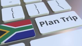 PLAN TRIP text and flag of South Africa on the computer keyboard, travel related 3D rendering. Text and flag on the buttons on the computer keyboard. 3D stock illustration