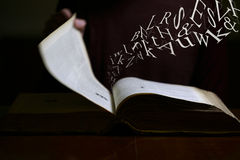 Text Flying out of Old Book. Text Flying out of an old book Stock Photos