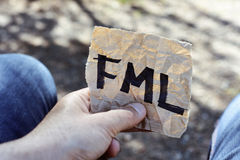 Text fml in a piece of paper Royalty Free Stock Images