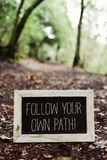 Text follow your own path Stock Photography