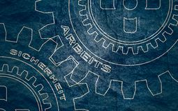 Text on the gears. Work and safety text on the mechanism of gears. An inscription in German. Communication concept in industrial design. Modern brochure design stock images