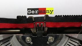 Text GERMANY written with the typewriter. BIG Text GERMANY written with an old vintage typewriter on white sheet stock footage
