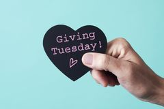 Free Text Giving Tuesday In A Heart-shaped Sign Stock Images - 164232884