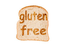 Text gluten free toasted on a slice of bread, isolated on white. Background Stock Photo