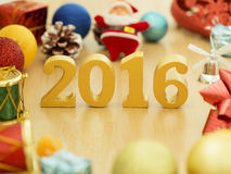 Text of gold 2016, make from wood. Golden year 2016. New year decoration, closeup on 2016 text. Happy new year 2016. Gold 2016 on Royalty Free Stock Photos