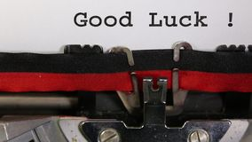 Text Good Luck written with the old typewriter. On white sheet stock video footage