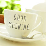Text good morning on a cup of coffee or tea Royalty Free Stock Photo