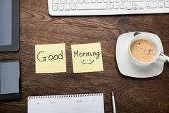 The Text Good Morning On Note With Cup Of Coffee Royalty Free Stock Images
