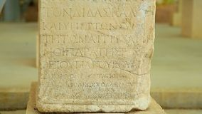 Text in Greek language on ancient stone table, antique exhibit at history museum. Stock footage stock footage