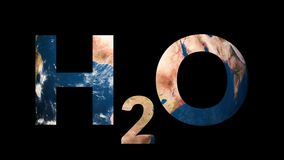 Text H2O water revealing turning Earth globe. 4K stock video footage