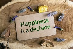 Happiness Is a Decision. Text Happiness Is a Decision in card on wood stock photography