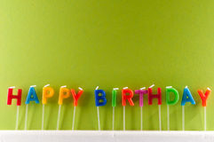 Text Happy Birthday. Many Colored Candles with Text Happy Birthday Royalty Free Stock Photo