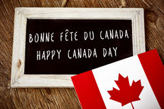 Text Happy Canada Day in French and English royalty free stock image