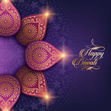 Text happy diwali. And decorations on purple background