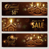 Text happy diwali special offer. 50 percent off and candle decorations on dark background