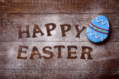 Text happy easter and decorated egg Royalty Free Stock Photography