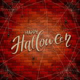Text Happy Halloween on brick wall with spiders Royalty Free Stock Image