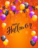 Lettering Happy Halloween with pennants and balloons on orange b. Text Happy Halloween on orange background with multicolored balloons, pennants, streamers and Royalty Free Stock Photography