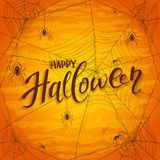 Text Happy Halloween on orange background with spiders Stock Images