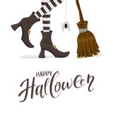 Text Happy Halloween with witches legs and broom Stock Photography