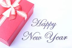 Text happy new year on paper with many balls and gift boxes Stock Photos