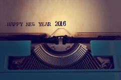 Text happy new year 2016 written with an old typewriter. Closeup of a yellowish paper with the text happy new year 2016 in an old blue typewriter stock image