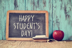 Text happy students day in a chalkboard stock photo