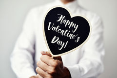 Text happy valentines day in heart-shaped signboard Royalty Free Stock Image