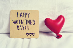Text happy valentines day in a note Royalty Free Stock Photo